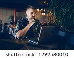 thoughtful bearded freelancer... | Shutterstock . vector #1292580010