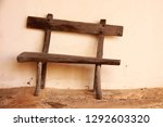 Small photo of awry wooden bench