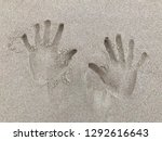 Hand Print Engraved In Sand At...