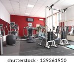 gym apparatus in a gym hall | Shutterstock . vector #129261950
