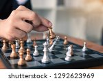 businessman playing chess game... | Shutterstock . vector #1292623969