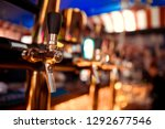 close up of barman hand at beer ...   Shutterstock . vector #1292677546