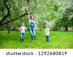 mom and two little daughters... | Shutterstock . vector #1292680819