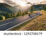 motorcycle driver riding in... | Shutterstock . vector #1292708179