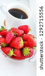 cup of coffee and strawberries. ... | Shutterstock . vector #1292715556
