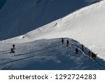 free ride skiers  skiing down... | Shutterstock . vector #1292724283