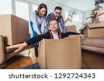 happy family moving home with...   Shutterstock . vector #1292724343