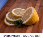 fresh lemon cut rings on bamboo ... | Shutterstock . vector #1292730100