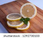 fresh lemon cut rings on bamboo ... | Shutterstock . vector #1292730103