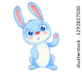 cute rabbit waving his paw.... | Shutterstock . vector #1292827030