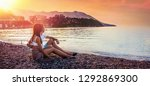 happy couple sits on the sea... | Shutterstock . vector #1292869300