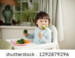 toddler girl eating  healthy ... | Shutterstock . vector #1292879296