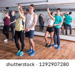 young sporty girls and men... | Shutterstock . vector #1292907280