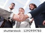 in the foreground.handshake of... | Shutterstock . vector #1292959783