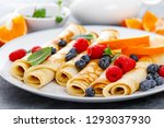 sweet pancakes wrapped with... | Shutterstock . vector #1293037930