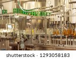 filling  glass bottles with... | Shutterstock . vector #1293058183