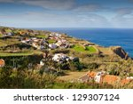 Aerial view to town over Atlantic ocean, San Miguel, Azores, Portugal - stock photo
