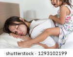 tired mother trying to sleep...   Shutterstock . vector #1293102199