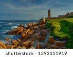 lighthouse among the red rocks... | Shutterstock . vector #1293111919