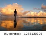 Silhouetted Woman Standing In A ...