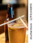 Small photo of Miami, FL / USA - June 1, 218: Unspecified beer served in a glass at a local Asian restaurant.