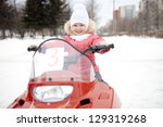 the girl on a snowmobile. | Shutterstock . vector #129319268