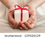 female hands holding small gift ... | Shutterstock . vector #129320129
