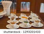 white cup for flavoring. | Shutterstock . vector #1293201433