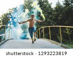 the guy is holding a smoke... | Shutterstock . vector #1293223819