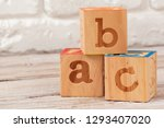 wooden toy blocks with the text ... | Shutterstock . vector #1293407020