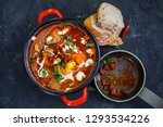 goulash soup in red pot and... | Shutterstock . vector #1293534226