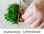 a woman shreds parsley with...   Shutterstock . vector #1293535420