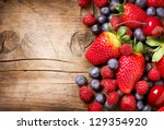 berries on wooden background.... | Shutterstock . vector #129354920