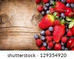 berries on wooden background.... | Shutterstock . vector #129354920