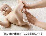 mother changing a tiny newborn... | Shutterstock . vector #1293551446