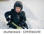 little cute boy is having fun... | Shutterstock . vector #1293566140