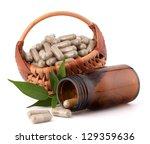 herbal drug capsules in wicker... | Shutterstock . vector #129359636