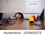 child boy playing in living... | Shutterstock . vector #1293601573