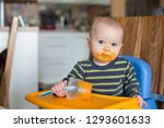 little baby boy  eating mashed... | Shutterstock . vector #1293601633