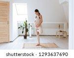 Young Pregnant Yoga Woman...