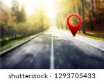 red gps pin on asphalt road and ... | Shutterstock . vector #1293705433
