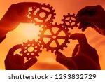 gears in the hands of people on ... | Shutterstock . vector #1293832729