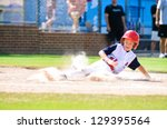 Youth Baseball Player Sliding...