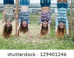 four young girls hanging upside ... | Shutterstock . vector #129401246