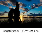 silhouette of two young women... | Shutterstock . vector #1294025173