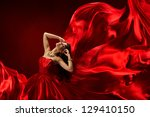woman in red dress blowing with ... | Shutterstock . vector #129410150