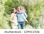 young happy family of three... | Shutterstock . vector #129411536
