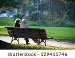 two senior sat on a bench | Shutterstock . vector #129411746