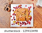 Christmas cake on silver plate from above - stock photo