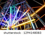 Bright and local Ferris wheel at Thai temple fairs, night time